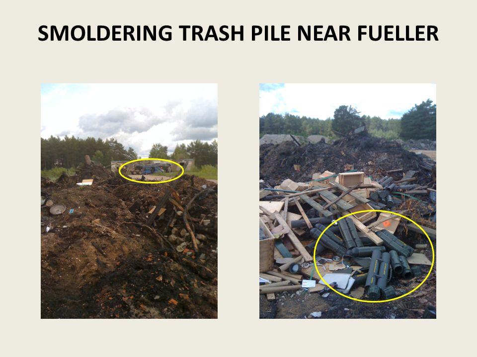 SMOLDERING TRASH PILE NEAR FUELLER