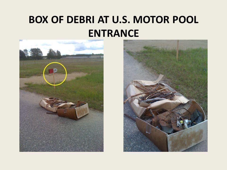 BOX OF DEBRI AT U.S. MOTOR POOL ENTRANCE