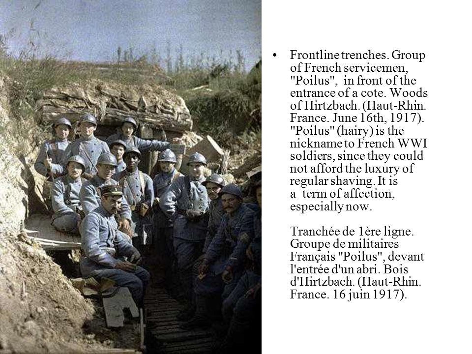 Frontline trenches. Group of French servicemen, Poilus , in front of the entrance of a cote.