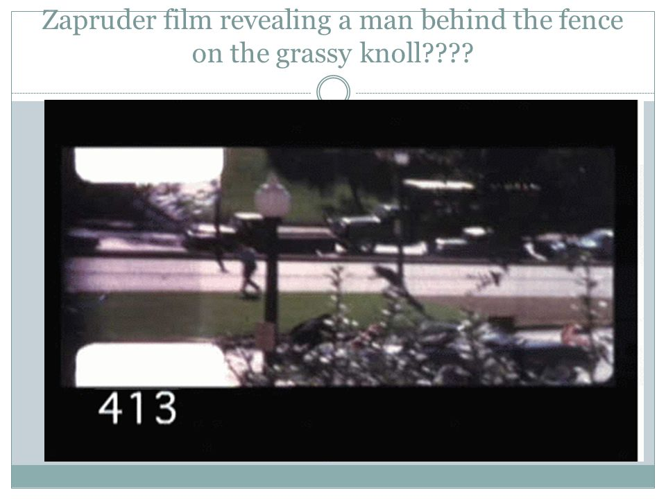 Zapruder film revealing a man behind the fence on the grassy knoll