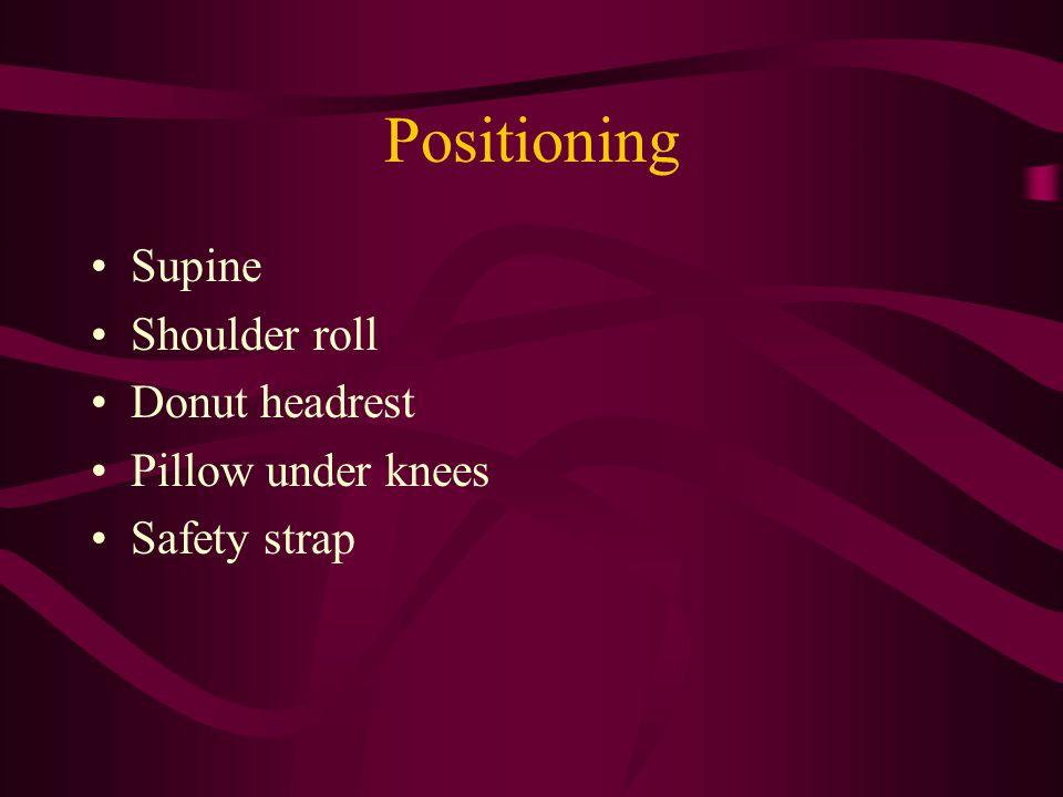 Positioning Supine Shoulder roll Donut headrest Pillow under knees Safety strap