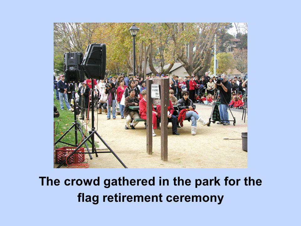 The crowd gathered in the park for the flag retirement ceremony