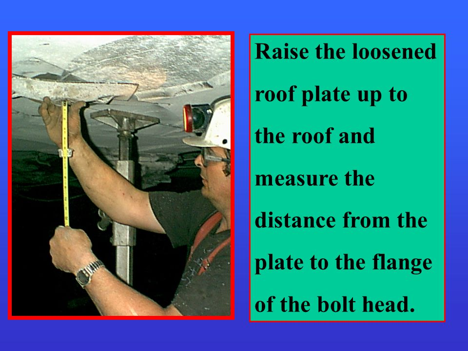 Raise the loosened roof plate up to the roof and measure the distance from the plate to the flange of the bolt head.