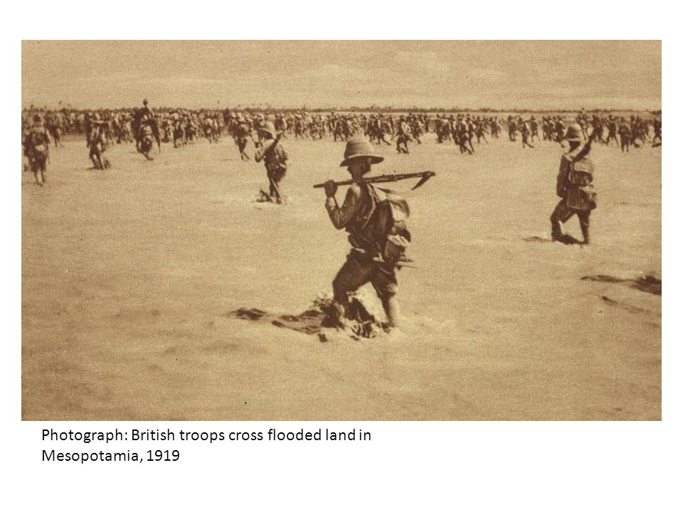 Photograph: British troops cross flooded land in Mesopotamia, 1919