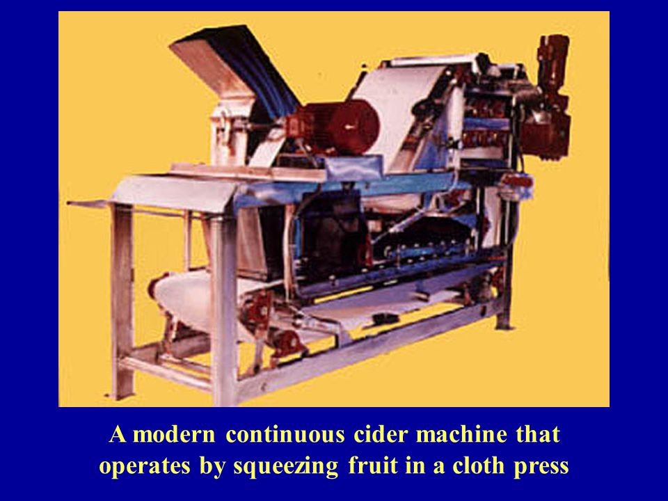 A modern continuous cider machine that operates by squeezing fruit in a cloth press