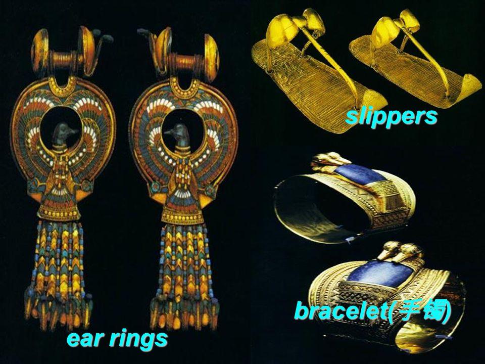 gold coffin 金棺 gold mask a gold box containing the king's inside a gold box containing the king's inside ear rings bracelet( 手镯 ) bracelet( 手镯 ) slippers