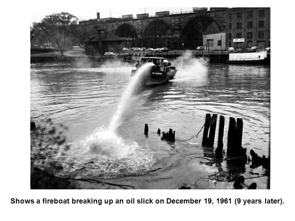 Shows a fireboat breaking up an oil slick on December 19, 1961 (9 years later).