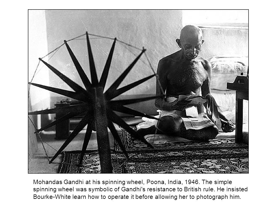 Mohandas Gandhi at his spinning wheel, Poona, India, 1946.
