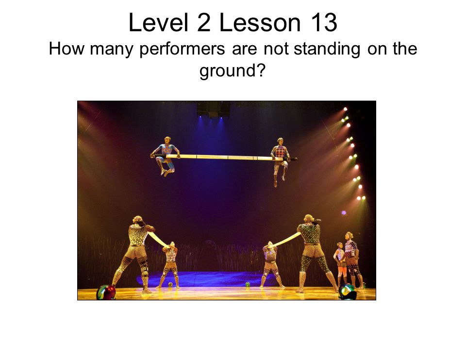 Level 2 Lesson 13 How many performers are not standing on the ground?