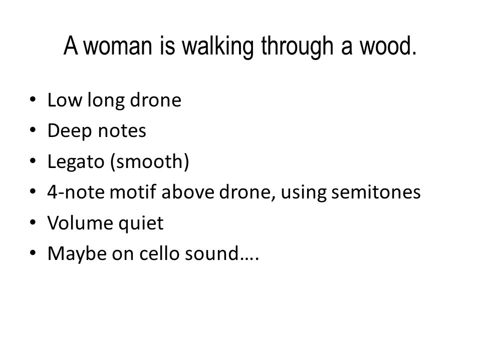 A woman is walking through a wood.