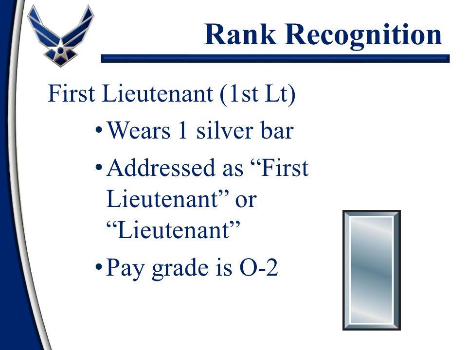 "First Lieutenant (1st Lt) Wears 1 silver bar Addressed as ""First Lieutenant"" or ""Lieutenant"" Pay grade is O-2 Rank Recognition"