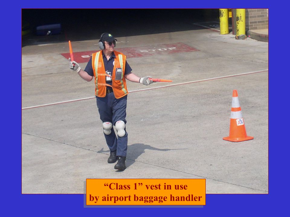 """Class 1"" vest in use by airport baggage handler ""Class 1"" vest in use by airport baggage handler"