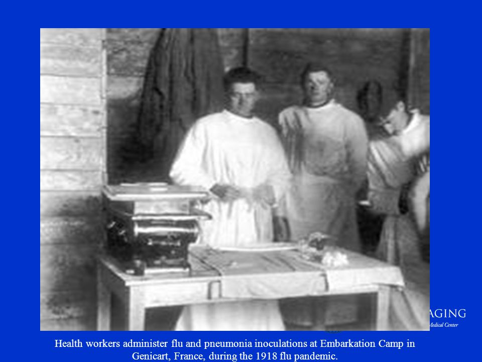 Health workers administer flu and pneumonia inoculations at Embarkation Camp in Genicart, France, during the 1918 flu pandemic.