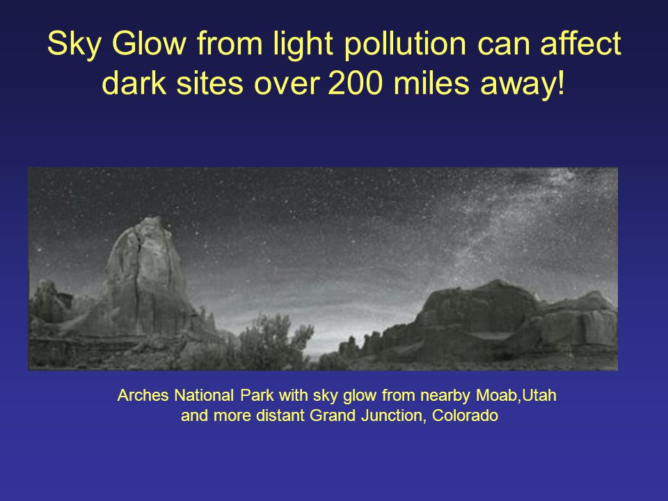 Sky Glow from light pollution can affect dark sites over 200 miles away! Arches National Park with sky glow from nearby Moab,Utah and more distant Gra