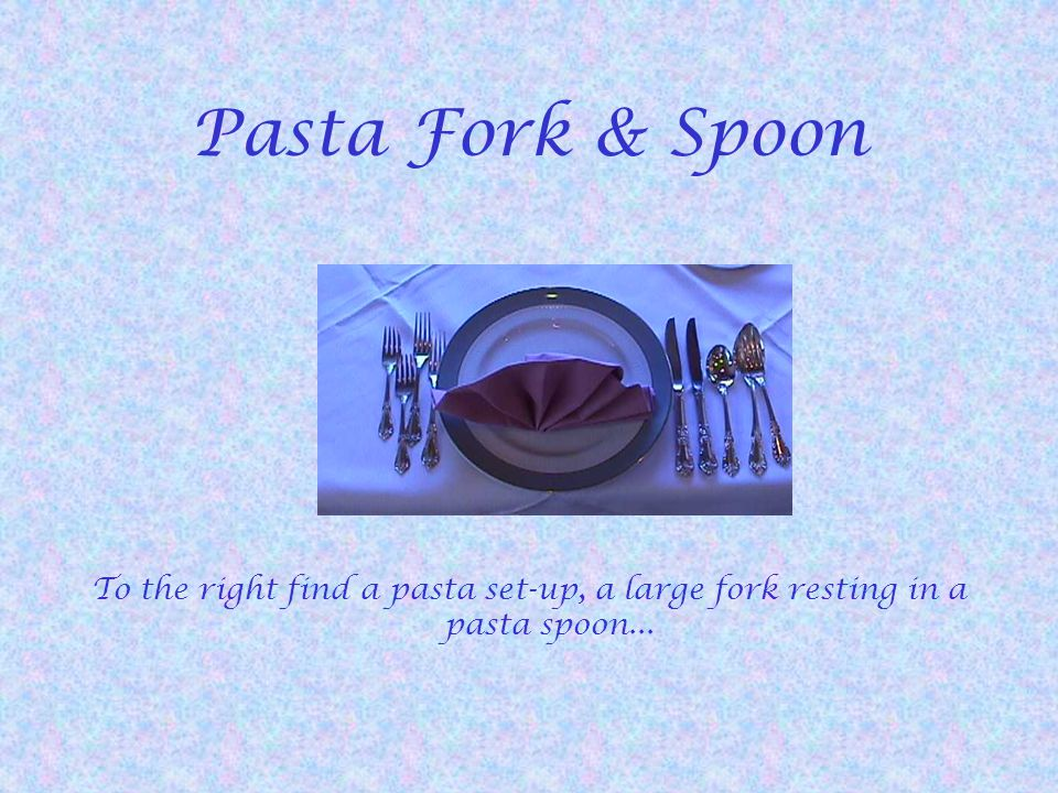 Pasta Fork & Spoon To the right find a pasta set-up, a large fork resting in a pasta spoon...