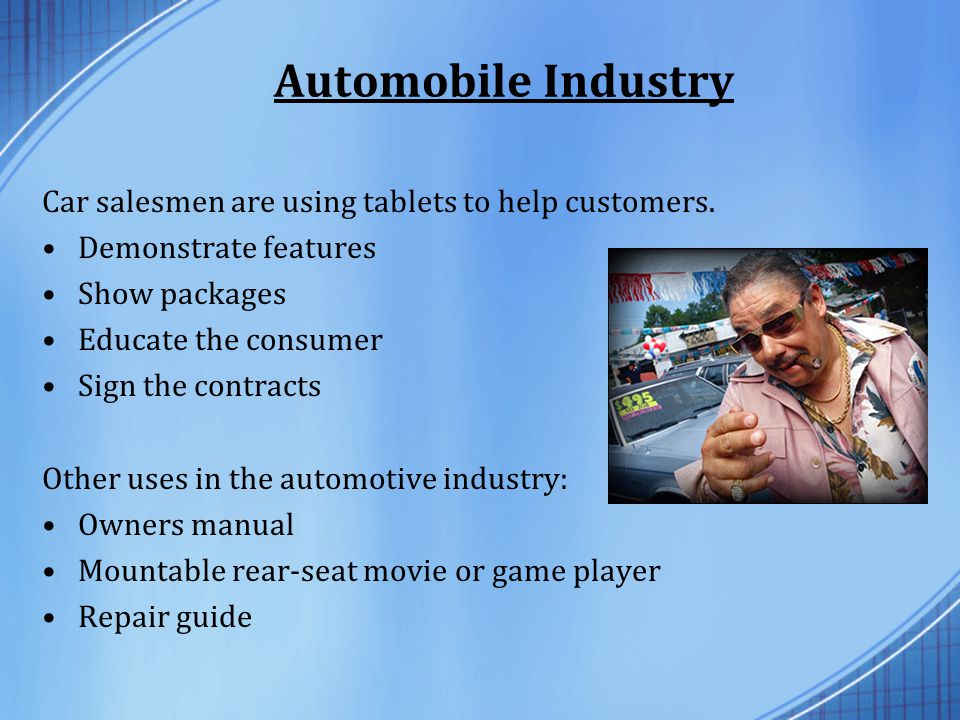 Automobile Industry Car salesmen are using tablets to help customers.
