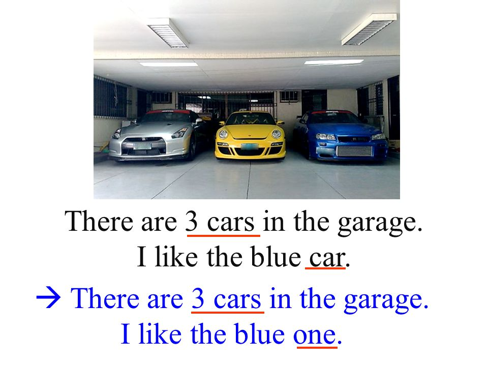 There are 3 cars in the garage. I like the blue car.