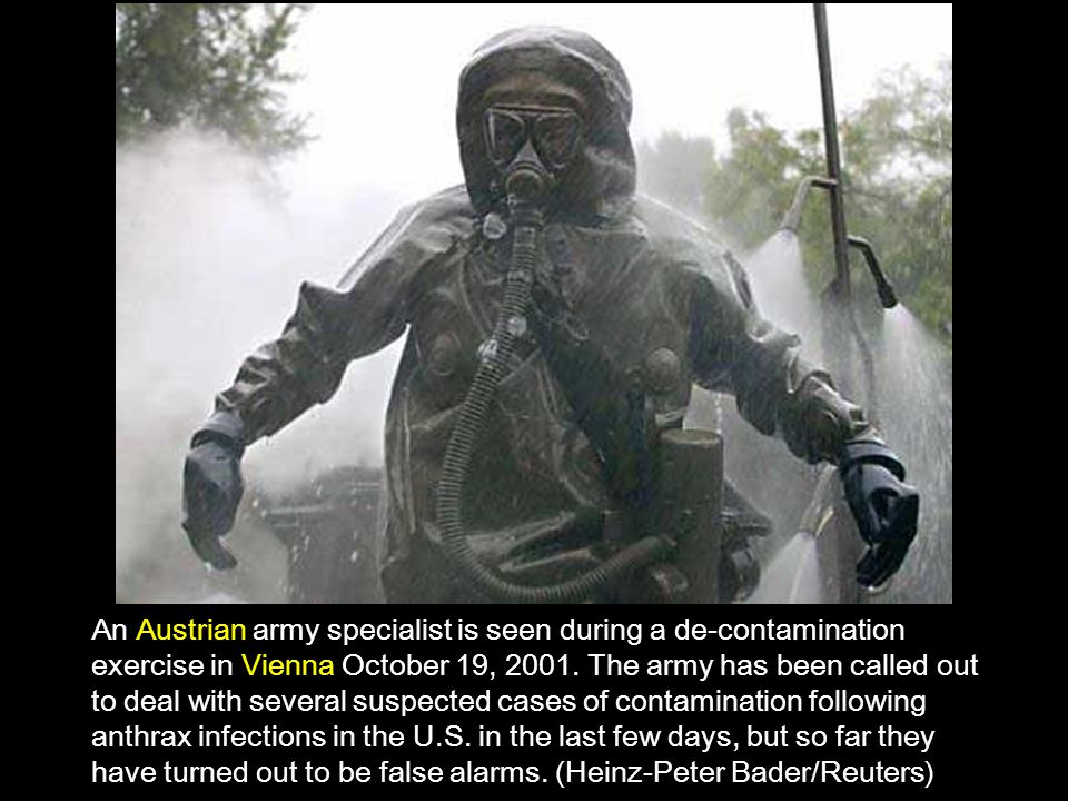 An Austrian army specialist is seen during a de-contamination exercise in Vienna October 19, 2001.