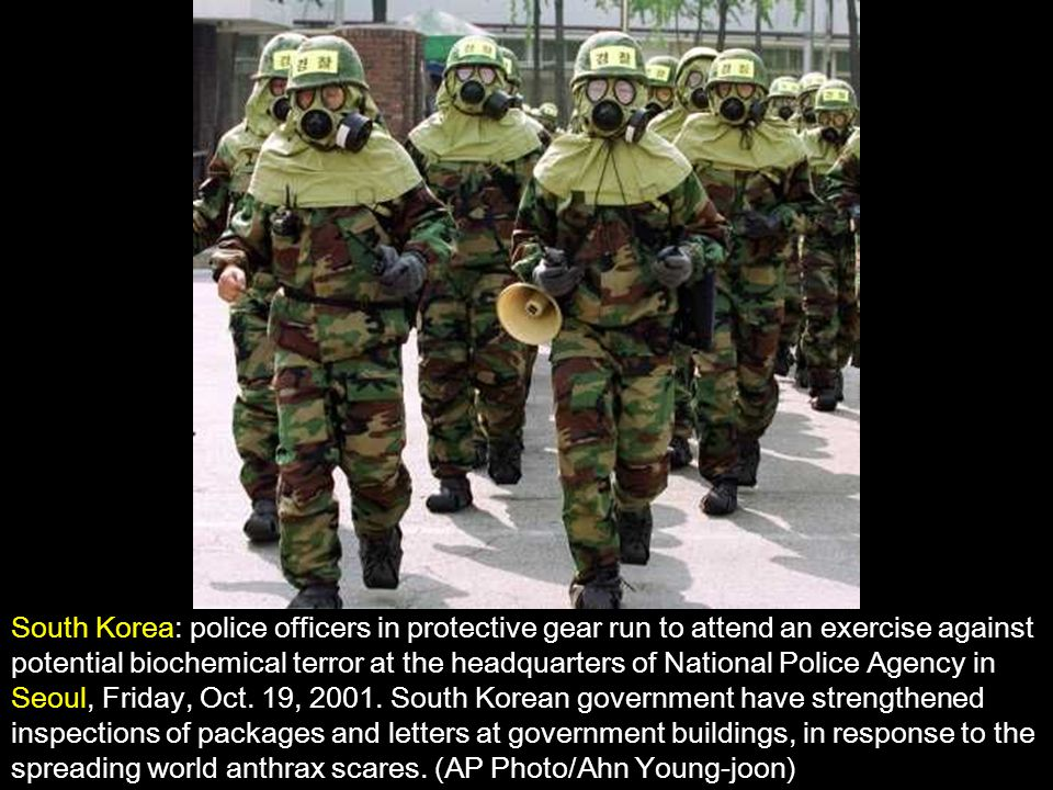 South Korea: police officers in protective gear run to attend an exercise against potential biochemical terror at the headquarters of National Police Agency in Seoul, Friday, Oct.