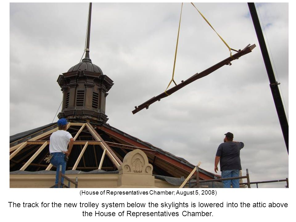 The track for the new trolley system below the skylights is lowered into the attic above the House of Representatives Chamber. (House of Representativ