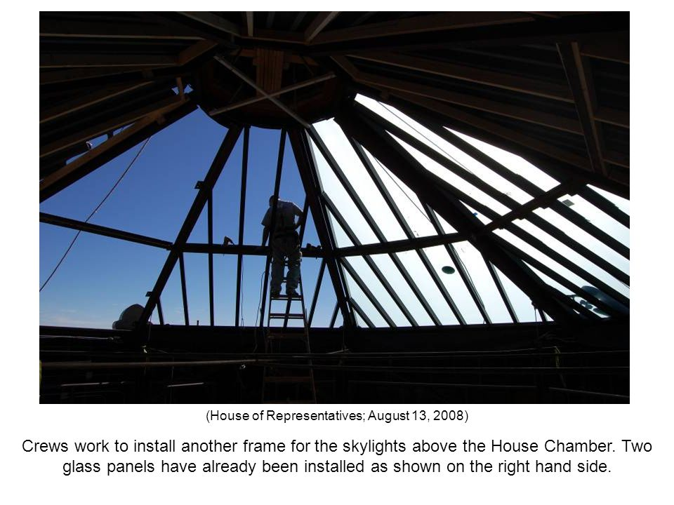 Crews work to install another frame for the skylights above the House Chamber. Two glass panels have already been installed as shown on the right hand