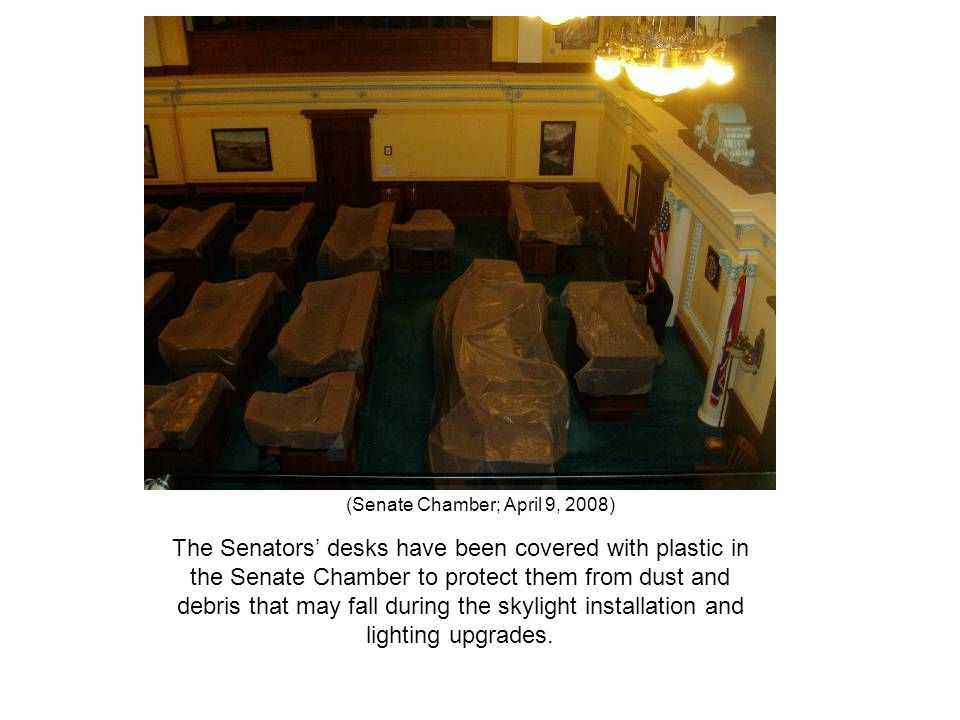 (Senate Chamber; April 9, 2008) The Senators' desks have been covered with plastic in the Senate Chamber to protect them from dust and debris that may