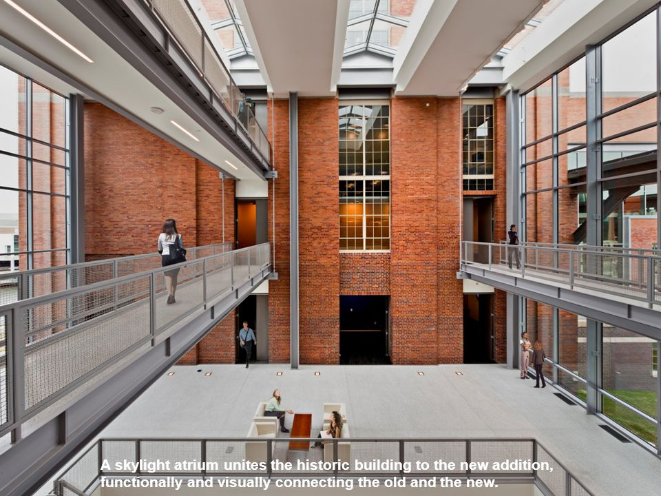A skylight atrium unites the historic building to the new addition, functionally and visually connecting the old and the new.