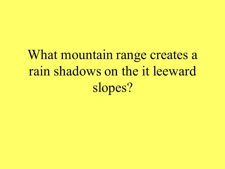 What mountain range creates a rain shadows on the it leeward slopes?