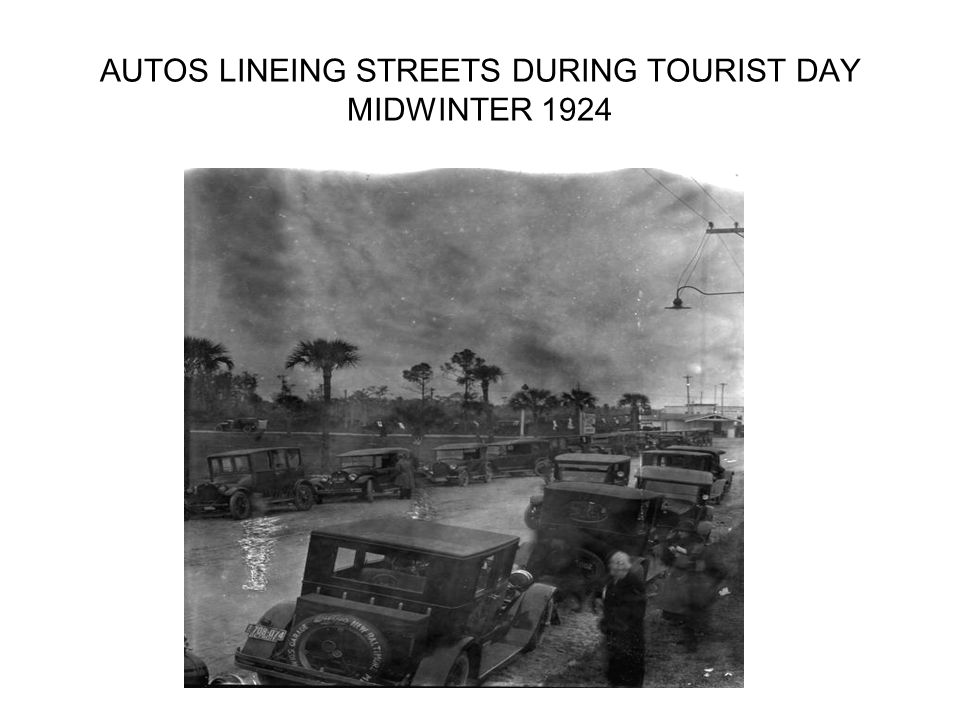 AUTOS LINEING STREETS DURING TOURIST DAY MIDWINTER 1924