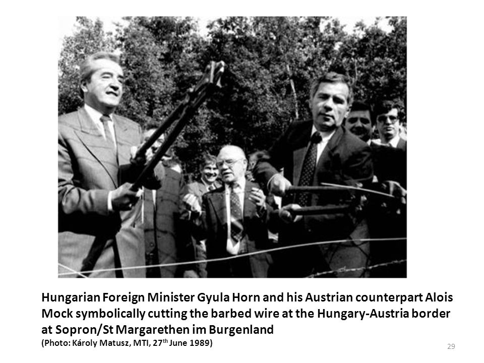 Hungarian Foreign Minister Gyula Horn and his Austrian counterpart Alois Mock symbolically cutting the barbed wire at the Hungary-Austria border at Sopron/St Margarethen im Burgenland (Photo: Károly Matusz, MTI, 27 th June 1989) 29