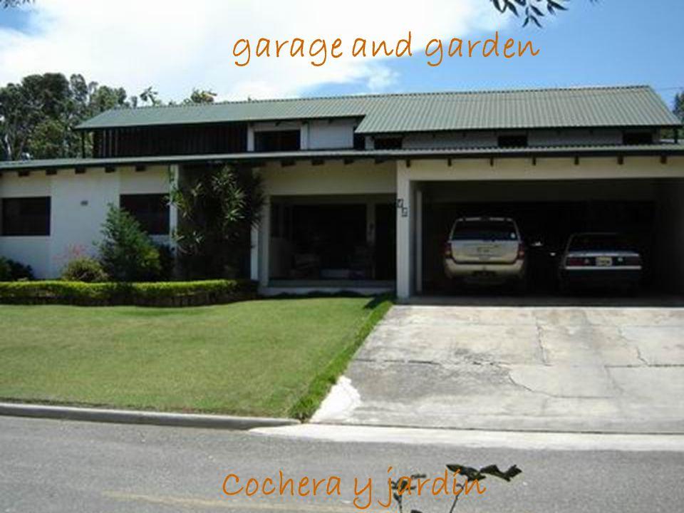 garage and garden Cochera y jardín