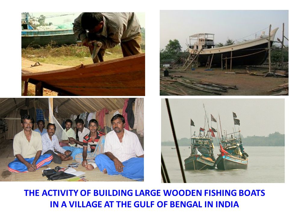 THE ACTIVITY OF BUILDING LARGE WOODEN FISHING BOATS IN A VILLAGE AT THE GULF OF BENGAL IN INDIA
