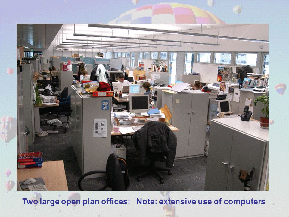 Two large open plan offices: Note: extensive use of computers