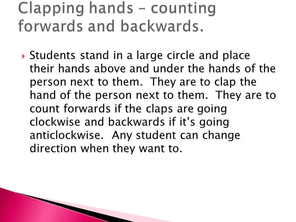  Students stand in a large circle and place their hands above and under the hands of the person next to them.