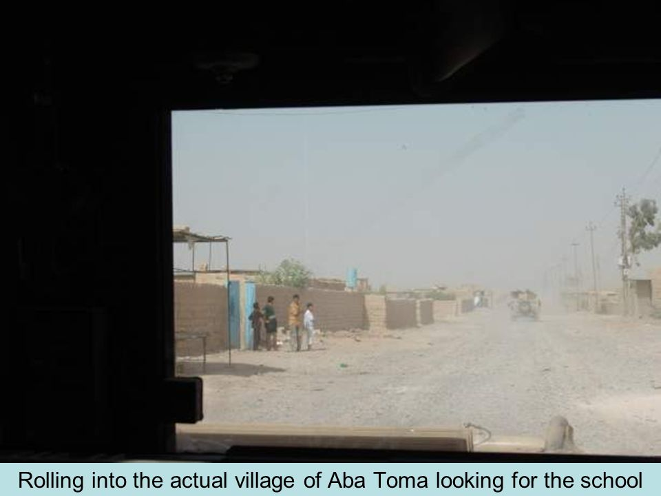 Rolling into the actual village of Aba Toma looking for the school
