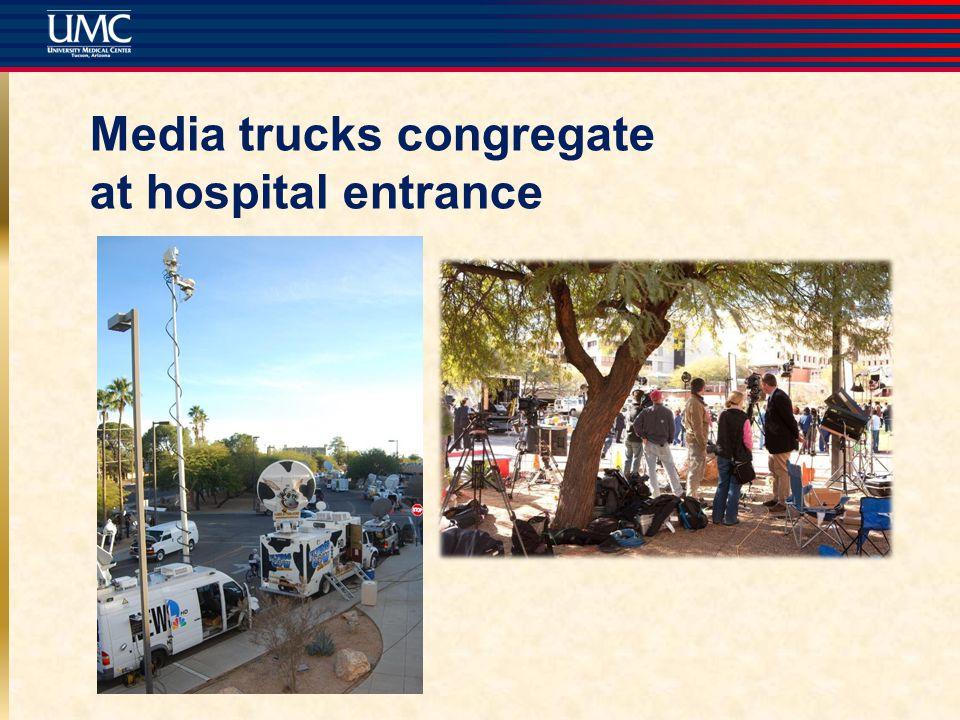 Media trucks congregate at hospital entrance