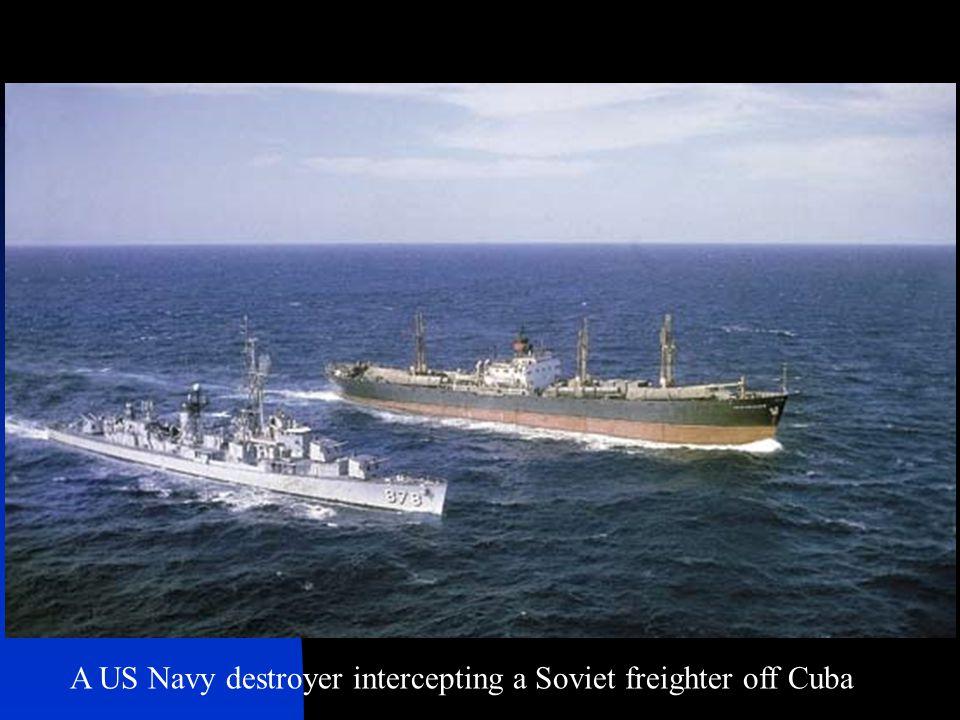 A US Navy destroyer intercepting a Soviet freighter off Cuba