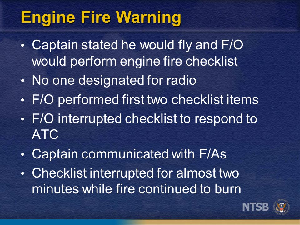 Engine Fire Warning Captain stated he would fly and F/O would perform engine fire checklist No one designated for radio F/O performed first two checklist items F/O interrupted checklist to respond to ATC Captain communicated with F/As Checklist interrupted for almost two minutes while fire continued to burn