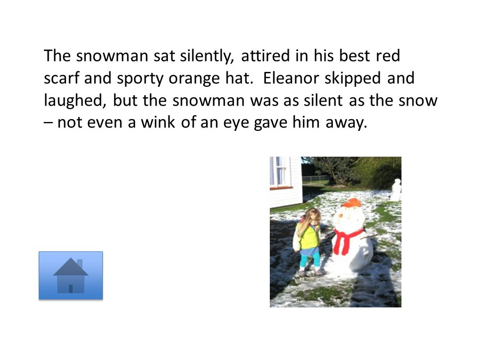 The snowman sat silently, attired in his best red scarf and sporty orange hat.