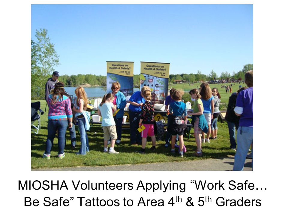 "MIOSHA Volunteers Applying ""Work Safe… Be Safe"" Tattoos to Area 4 th & 5 th Graders"