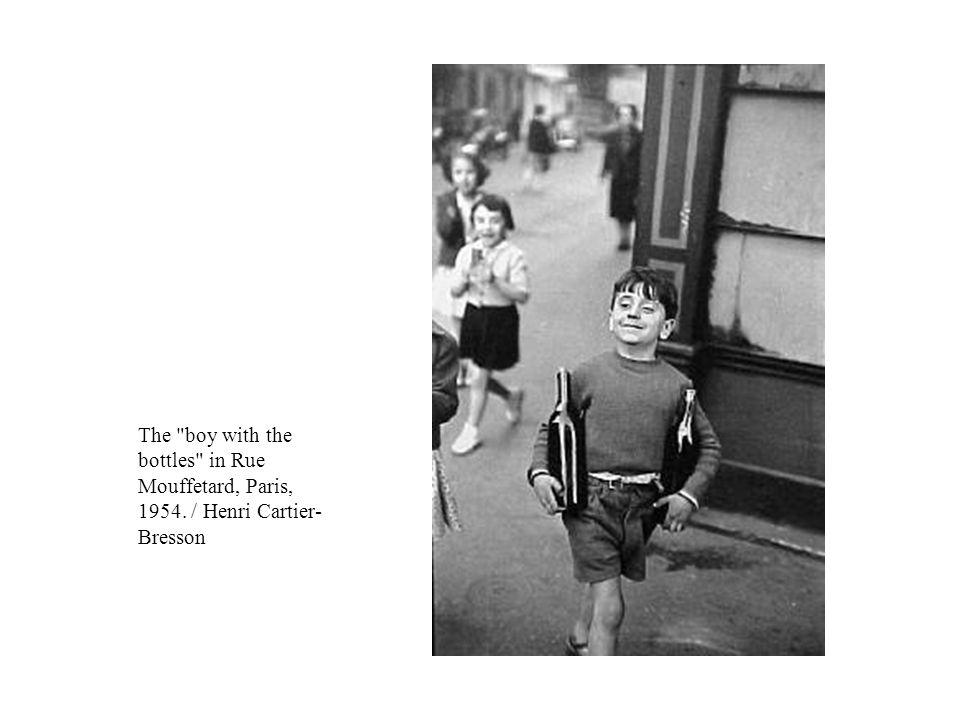The boy with the bottles in Rue Mouffetard, Paris, 1954. / Henri Cartier- Bresson