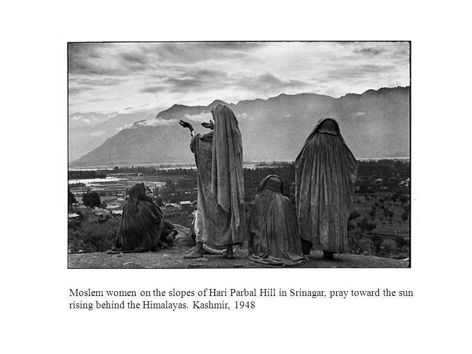 Moslem women on the slopes of Hari Parbal Hill in Srinagar, pray toward the sun rising behind the Himalayas.