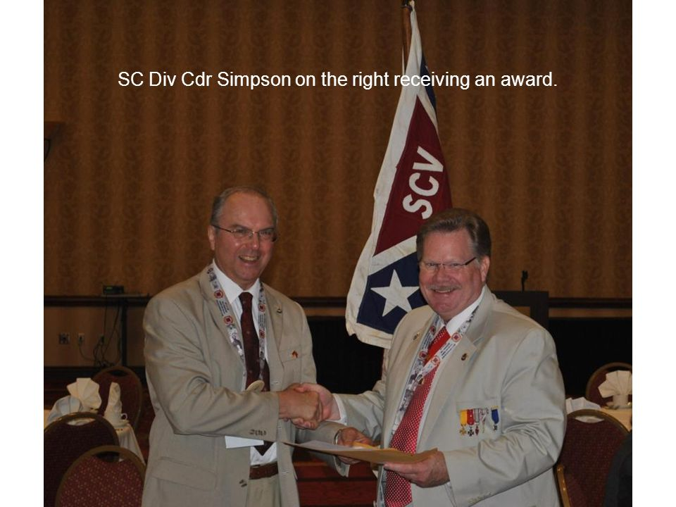 SC Div Cdr Simpson on the right receiving an award.
