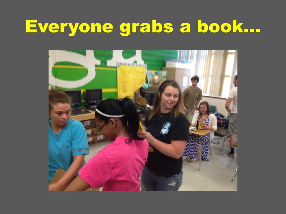 Everyone grabs a book…