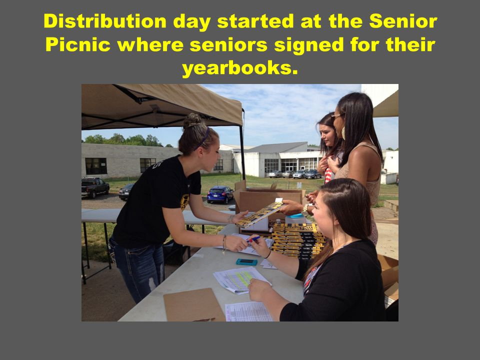 Distribution day started at the Senior Picnic where seniors signed for their yearbooks.