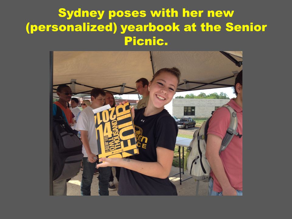 Sydney poses with her new (personalized) yearbook at the Senior Picnic.