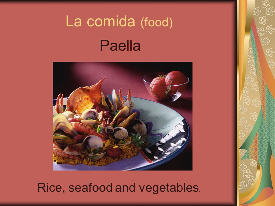 La comida (food) Paella Rice, seafood and vegetables.