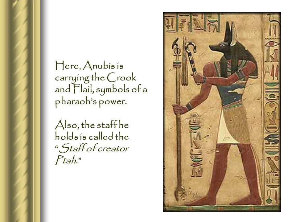 Here, Anubis is carrying the Crook and Flail, symbols of a pharaoh's power.