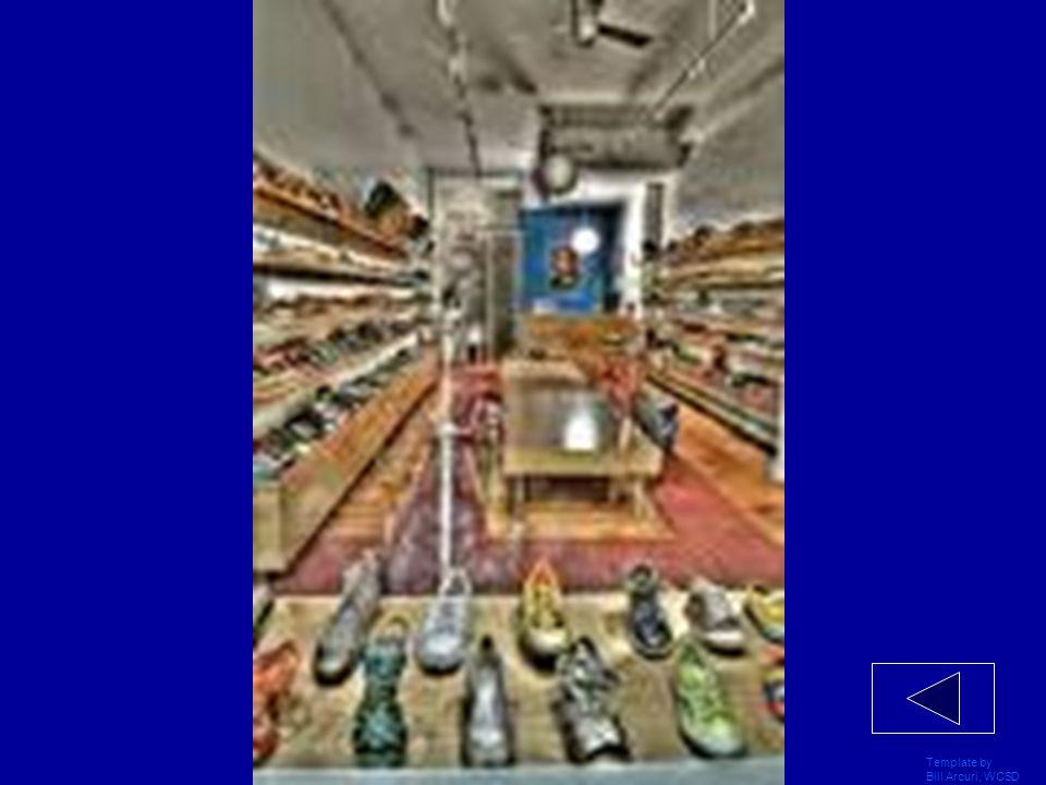 Template by Bill Arcuri, WCSD El carro azul está ____ el café y la tienda de deportes.