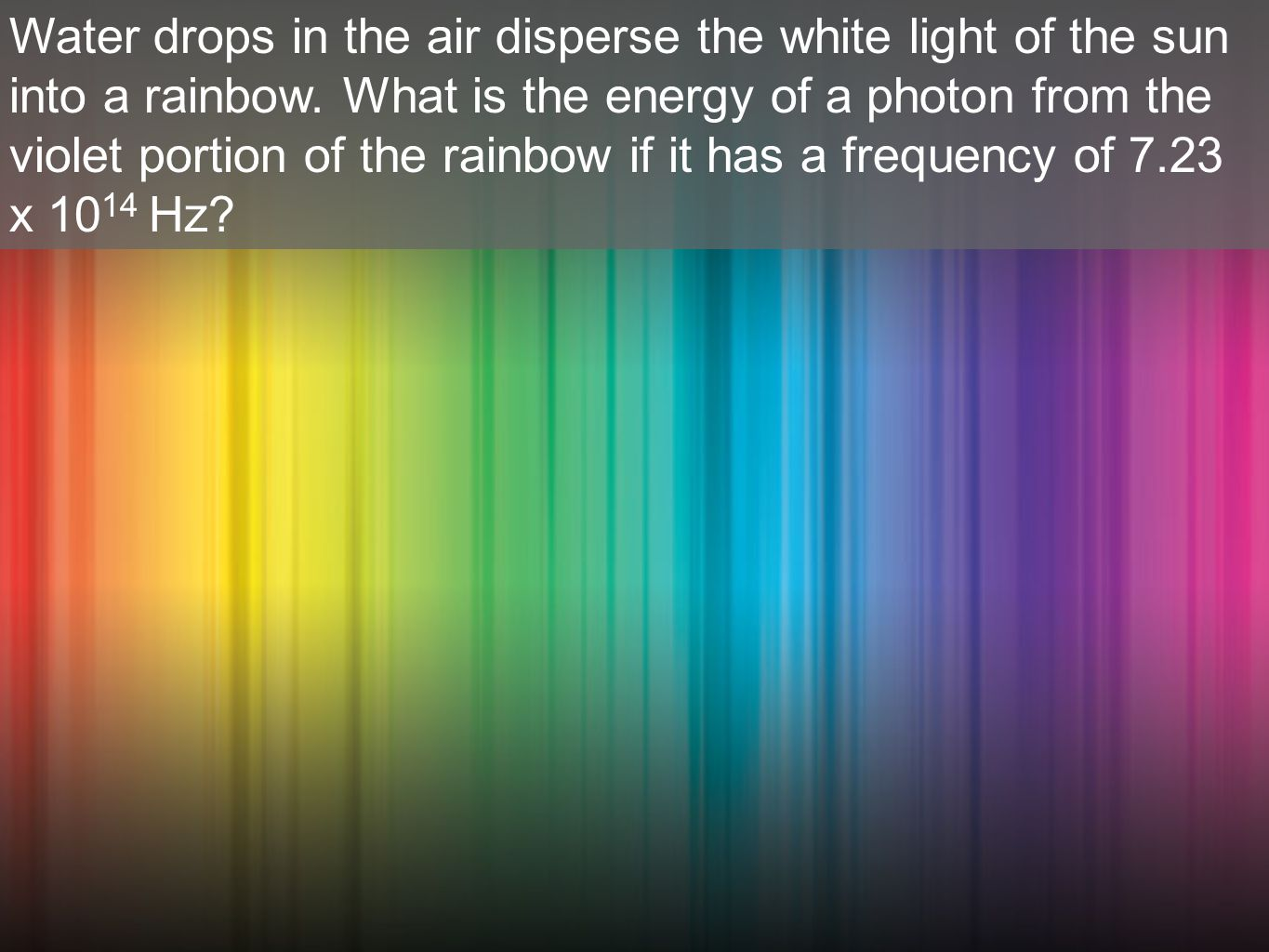 Water drops in the air disperse the white light of the sun into a rainbow.
